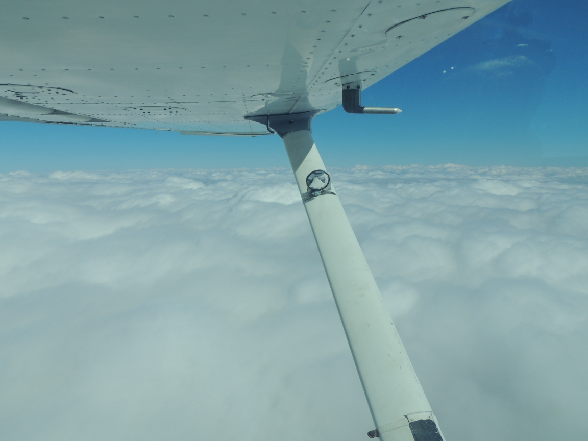 At 11,000 feet surfing the cloud tops heading home