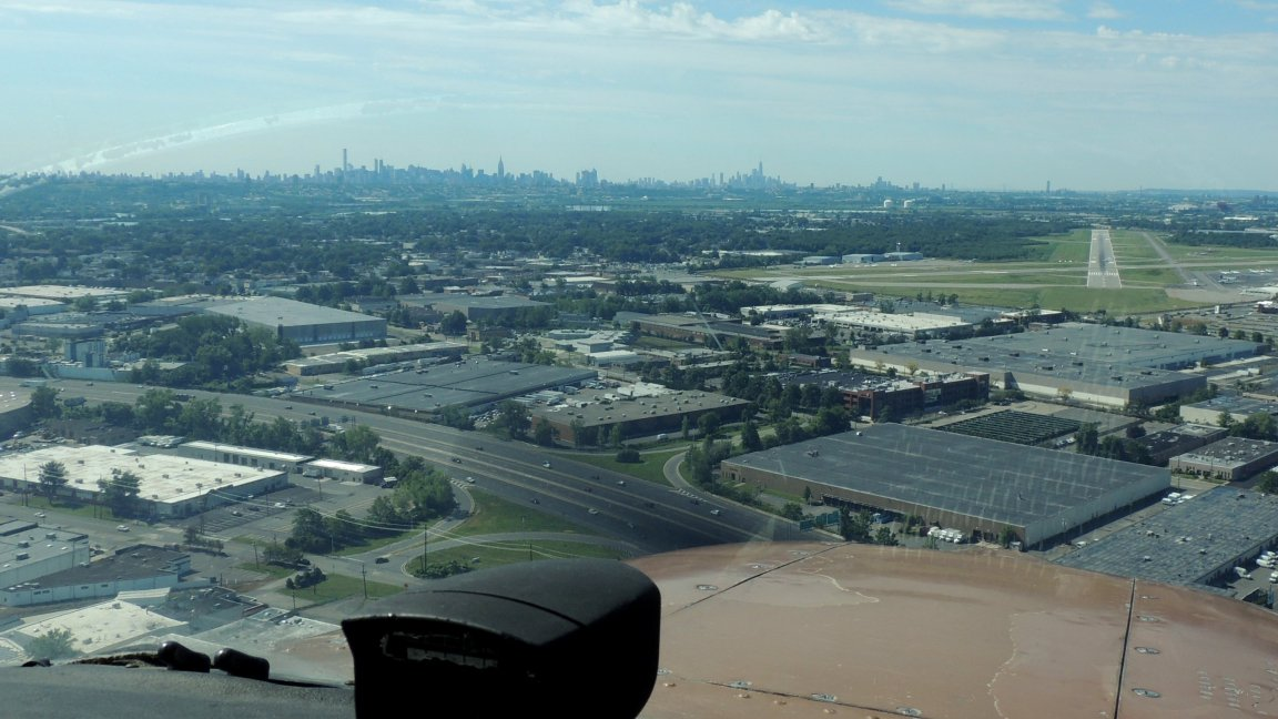 on final to runway 19 at Teterboro NJ (with New York City in the background)